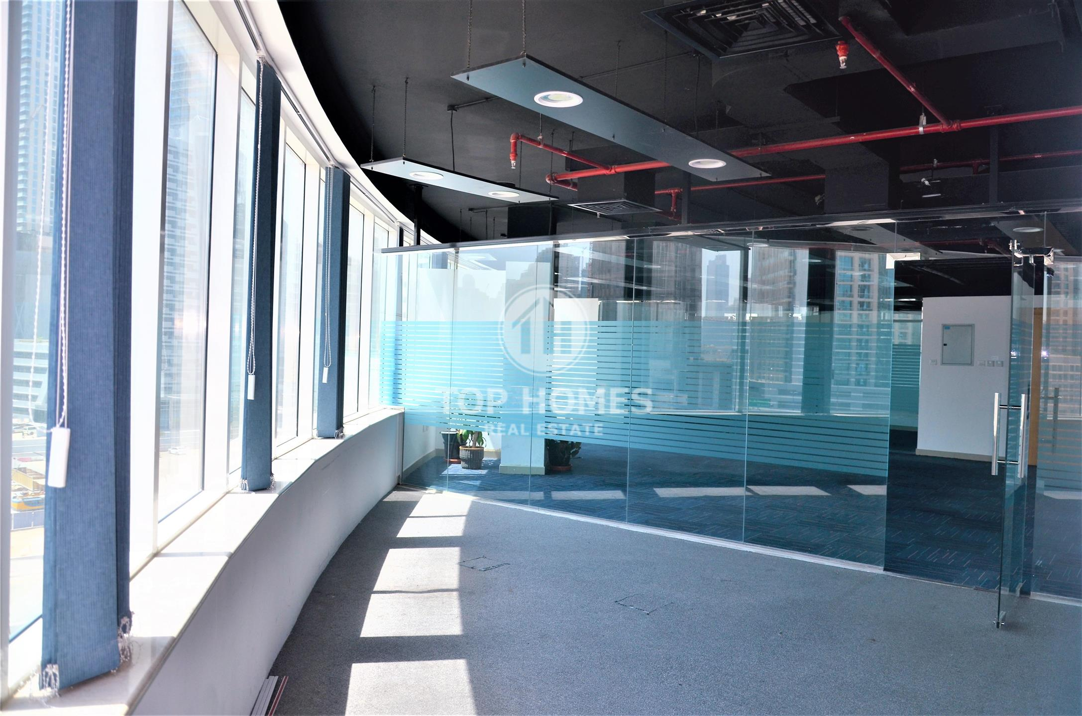 Large Furnished Office with Glass Partitions